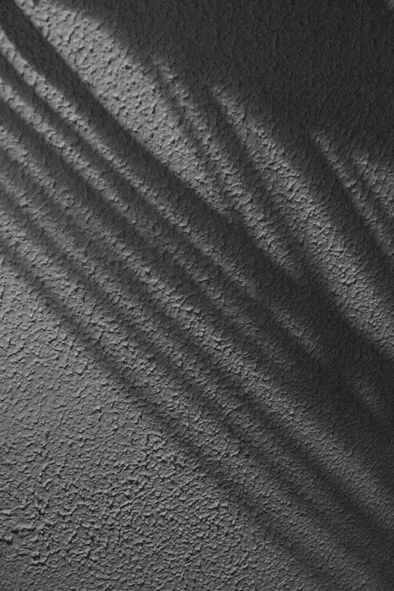 October 20, 2015:  Shadows of coat hangers trace against the textured wall.  Interesting things don't need to be complicated.  Still...life.