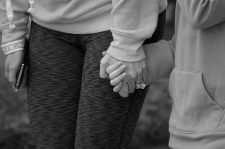 April 4, 2015:  Mother and daughter holding hands before a fun run; the community holding hands to raise money for a food bank.  Holding hands makes the world better.  Still...life.