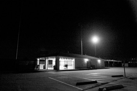 April 7, 2015:  There is something welcoming, private, moody and serene about parking lots at night...a place to pause, to feel, to think. The day's activities overtaken by darkness and shadows.  Still.  Still....life.