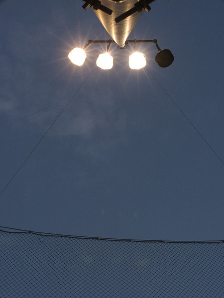 Baseball field light pole at twilight.