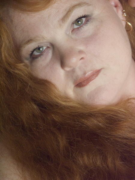 Portrait of natural beauty of Woman and red hair.