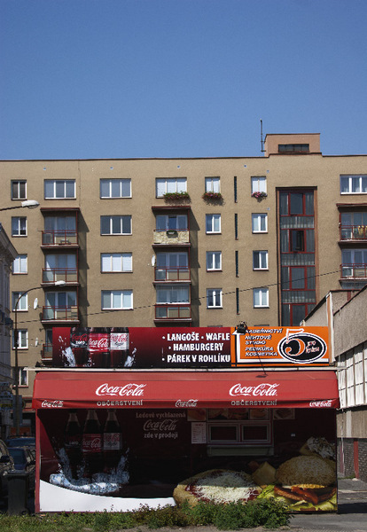 Plzen Czech Republic Coca-Cola diner in front of old apartments.