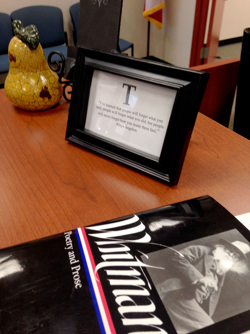 "March 6, 2015:  Checking in at the desk of Turner High School, prior to presenting to the seniors a topic inspired by Walt Whitman's poetry...I see this quote by Maya....""People will remember how you make them feel.""  I hope the students felt empowered to live their lives authentically.  Still...life."