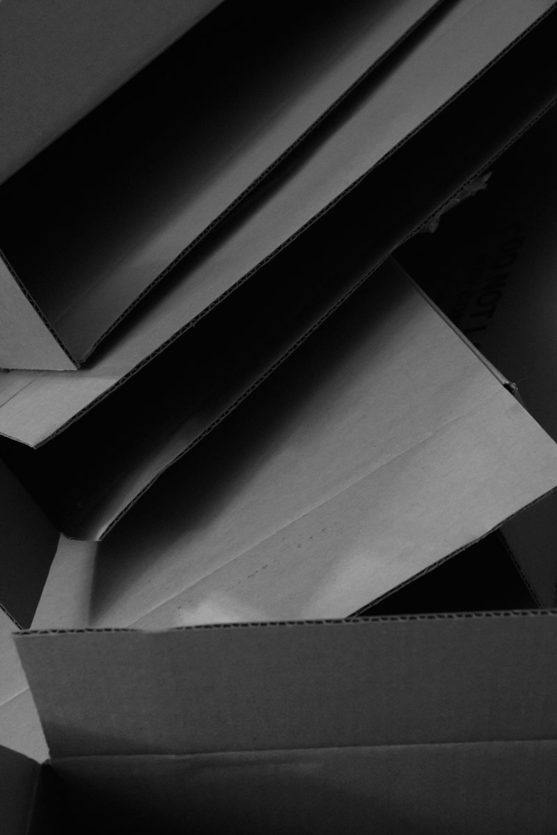 June 10, 2015:  Corrugated architecture, or architectural corrugated.  Things become other things with the magic of light and shadow.  Still...life.