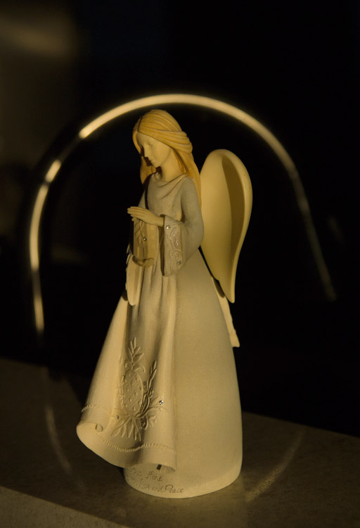 May 15  The angel statue captures my attention again, this time in the warm light of morning that creates a reflective halo of sorts from the kitchen faucet.  Simple beauty found simply.