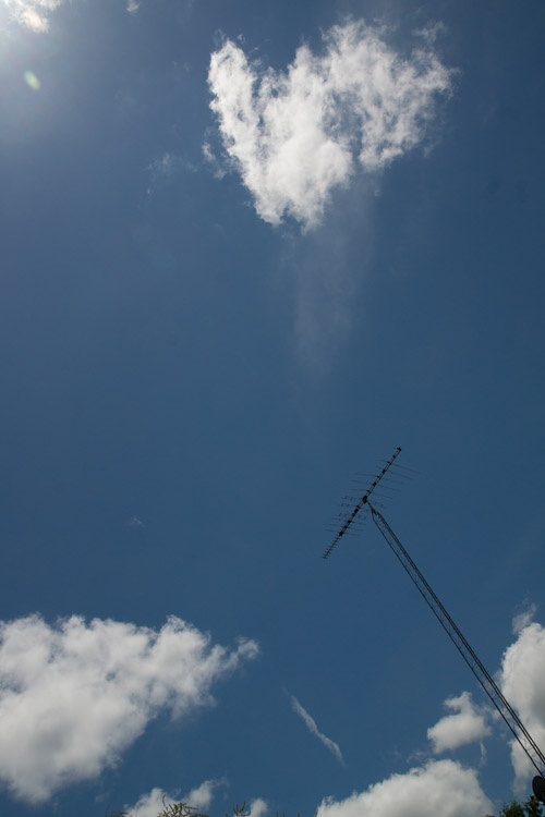 June 17   The storms, and their beauty, passed, giving way to the beauty of blue skies and clouds. Even the stark lines of the ham radio antenna seem beautiful with the sky.