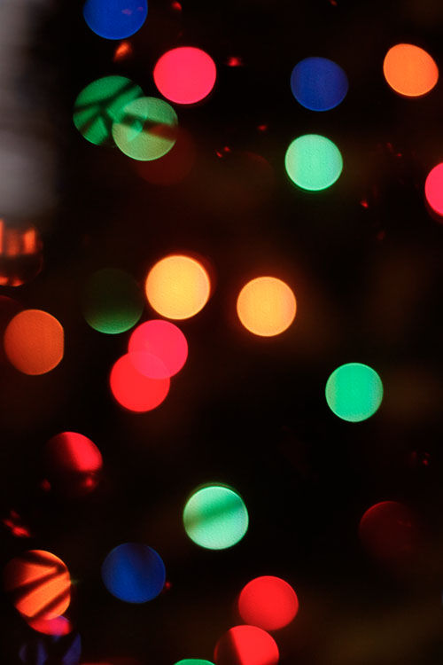 December 10   Out of focus, the Christmas tree lights become brightly colored bulbs amidst the ornaments.