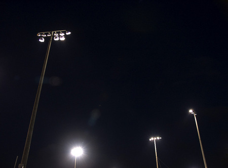 Little league lights at night.