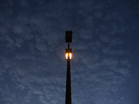 Parking lot light pole at twilight.