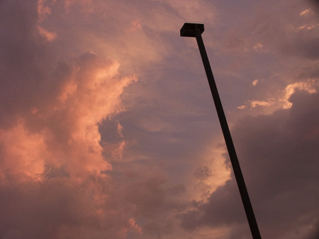 Parking lot light pole at sunset.