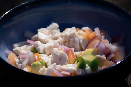 "February 10, 2015:  Ceviche:  raw fish ""cooked"" in the acid of lemon juice, onions, avocado, jalapeno and tomato.  Youngest son catches the fish and makes the tasty mix, proud of his success and treat.  Each day is a chance for treats...and color and spiciness.  Still...life."