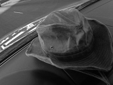 March 5, 2015:  I had to resort to a photo created with my phone while driving to a photo group for which I review images.  There, on the tollway, my hat caught my attention...a bit used, a bit worse for wear, but a whole lot of comfortable.  Not just my hat, but me too.  Still...life.