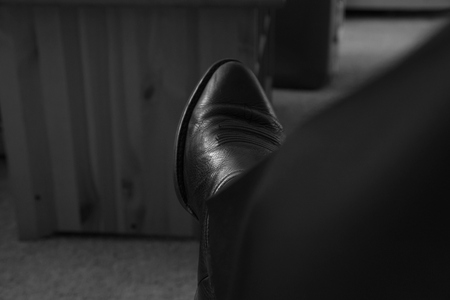 "August 19, 2015:  The end of my first day 'back in the saddle"" of work after a two-week road trip.  I began wearing boots in 1994; little did I know how much they fit my spirit, whether I'm in a suit or overalls.  Boots--where soul and sole meet the ground upon which I walk.  Still...life."