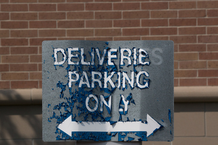 August 27, 2015:  Old and weathered--once a shiny new, blue sign standing starkly against the red brick backdrop--she still serves her role and service.  Duty before appearance.  Still...life.