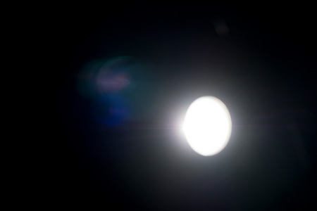 September 27, 2015:  We were all supposed to get excited about the rare occurrence of the Super Moon and the lunar eclipse.  This isn't it.  But  the moment I took the photo of my outdoor light was the only time that moment would happen in my life.  Still...life.