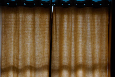 May 3  Warm morning light accentuates with textures and shadows the material of the drapes. I love light and shadows.